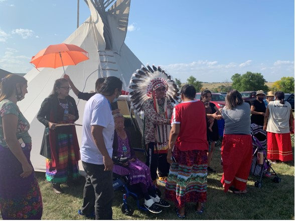 Lula Red Cloud, Matriarch of the Red Cloud family and Chief Henry Red Cloud accepting congratulations